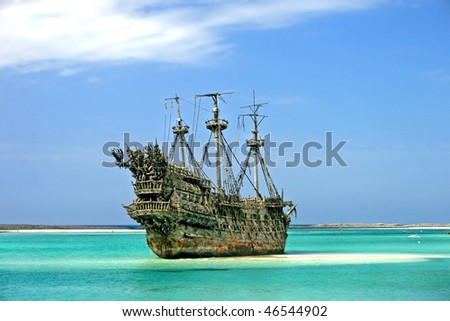 A replica of an old ship in the Caribbean. - stock photo