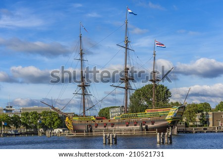 A replica (1985) of ship Amsterdam was moored next to Netherlands Maritime Museum in Amsterdam, Netherlands. VOC ship Amsterdam was an 18th century cargo ship of Dutch East India Company. - stock photo