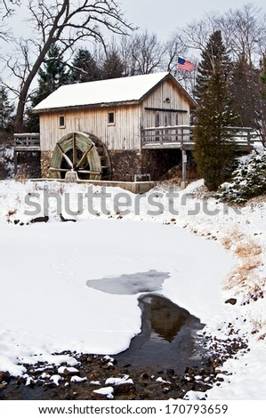 A replica of the 1839 Hiram Buttrick Mill, located on the Sequoit Creek in Antioch, IL. - stock photo