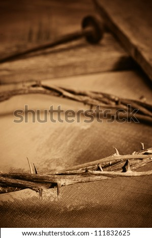 a representations of crown of thorns, cross and nails of Jesus Christ - stock photo
