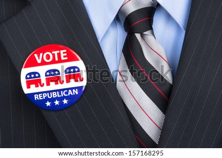 A republican voter proudly wears his party pin on his suit lapel. - stock photo