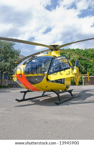 A rescue helicopter landed in a school area. - stock photo