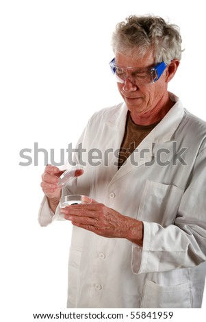 a research scientist examines a petri dish with a culture growing inside          isolated on white - stock photo