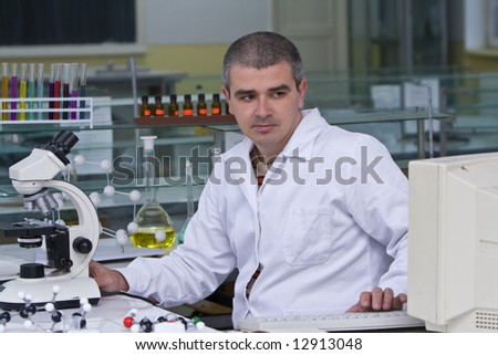 A researcher checking data on the computer computer at his workplace. - stock photo