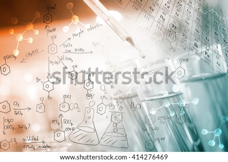 A researcher dropping the clear reagent into test tube with periodic table and chemical equations background, for reaction testing in chemical laboratory. - stock photo