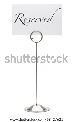 A reserved sign in a stainless steel card holder stand. Isolated on a pure white background. - stock photo