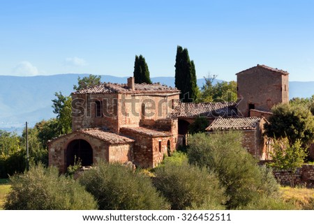 A residence in Tuscany, Italy. Typical for the region tuscan farm house, hills, cypress trees. Italy - stock photo