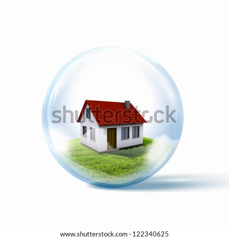 A residential house with red roof inside a glass sphere - stock photo