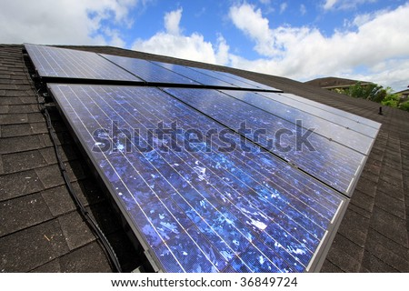 a residential mounted array of solar photovoltaic panels. - stock photo