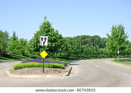 A Residential Street With A Landscaped Median - stock photo