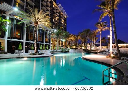 A resort swimming pool at twilight - stock photo