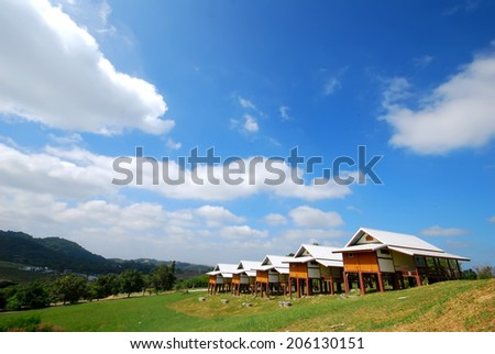 a rest home place. Behind the mountains and trees.  - stock photo
