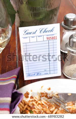 A restaurant dinnertime guest check left blank for placement of copy - stock photo