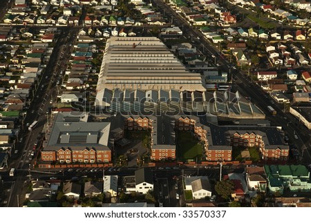 A resthome/hospital and bus depot sit in the middle of a residential area. - stock photo