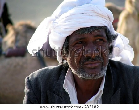 a resting bedouin deep in thought. - stock photo