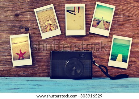 a retro camera and some instant photos of summer scenes, shot by myself, attached to a rustic wooden surface - stock photo