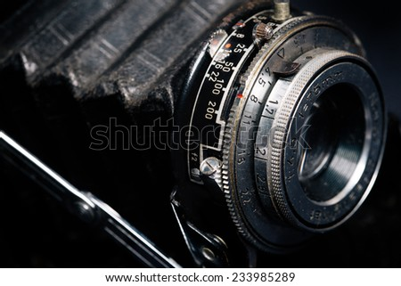 A retro camera lens close-up - stock photo