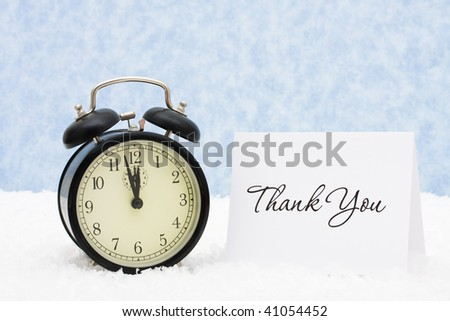 A retro clock with a thank you card snowflake background, thank you - stock photo