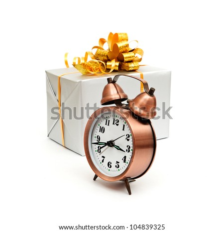 A retro clock with presents isolated on white