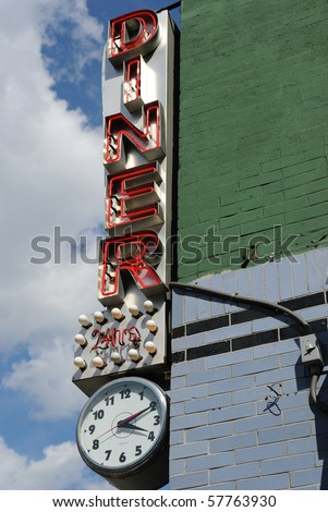 A retro diner sign with neon lights - stock photo