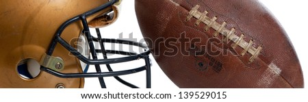 A retro football helmet and football on a white background - stock photo