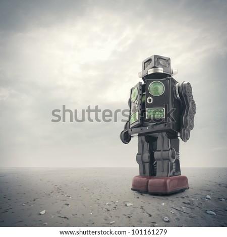 a  retro tin robot toy on an apocalyptic background - stock photo