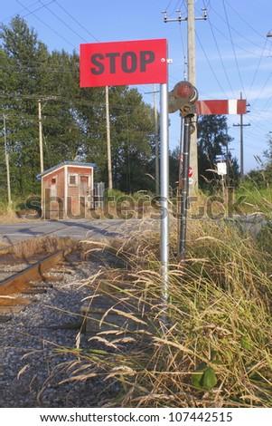 A retro train signal from the 1930's still in use in Western Canada/Retro Train Signal/A hand operated train signal still used for train and locomotive operations. - stock photo