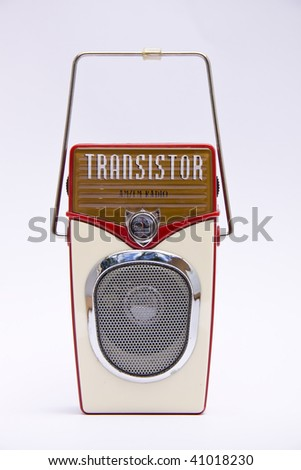 A retro transistor radio isolated over white - stock photo