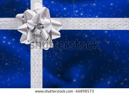 A ribbon and bow on a blue background, christmas present - stock photo