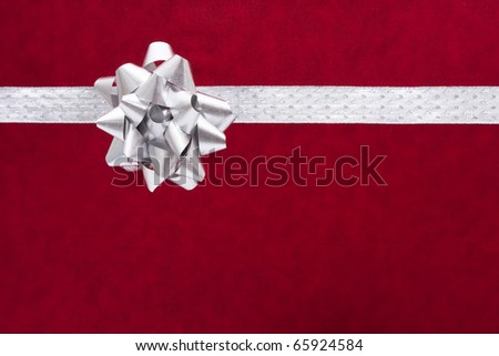 A ribbon and bow on a red background, christmas present - stock photo