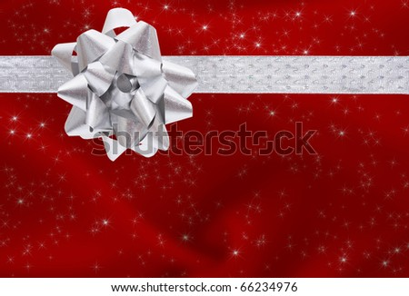 A ribbon and bow on a red background, christmas present background - stock photo