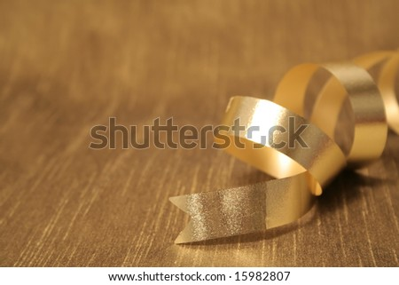 A ribbon sitting on a gold background