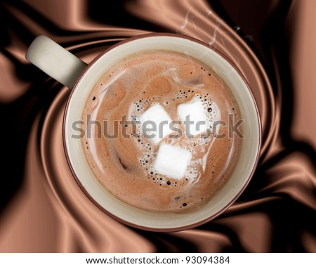 A rich cup of hot chocolate against a silky brown background - stock photo