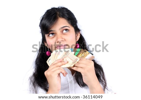 A rich Indian girl dreaming of ways to spend her money, on white studio background. - stock photo