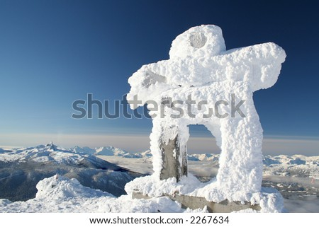 A rime covered Inuksuk greets visitors to the Whistler Valley. - stock photo