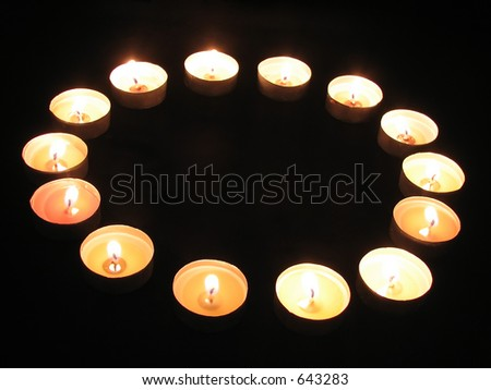 A ring of tea-light candles - stock photo