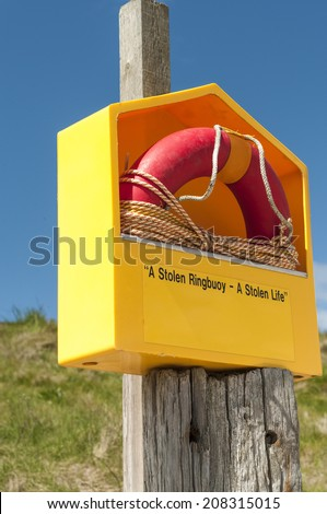 A ringbuoy on Ardmore beach in County Waterford, Ireland. - stock photo