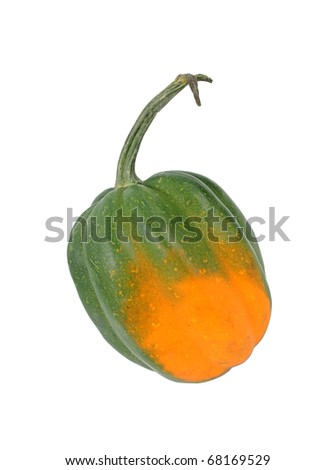 A ripe acorn squash on a white background.