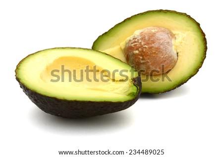 A ripe avocado fruit on white background - stock photo