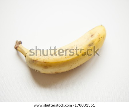 A ripe banana on a white background