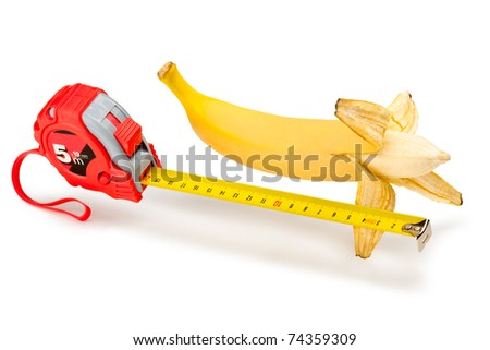 A ripe banana, the length of which decided to learn with tape-measure - stock photo