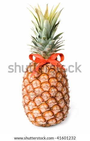 A ripe pineapple on a white background c red bow