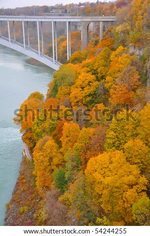 A river bank in the autumn - stock photo