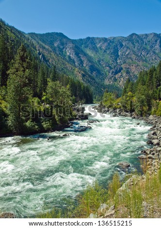 A River Flowing Through a Mountain Forest - Wenatchee River Washington USA - stock photo