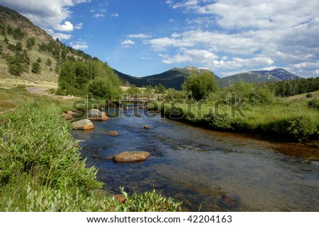 a river in the valley of rocky mountain national park - stock photo