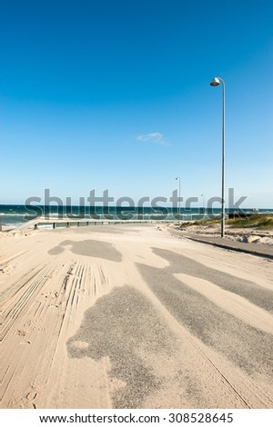 A road covered with sand in Hirtshals, Denmark - stock photo