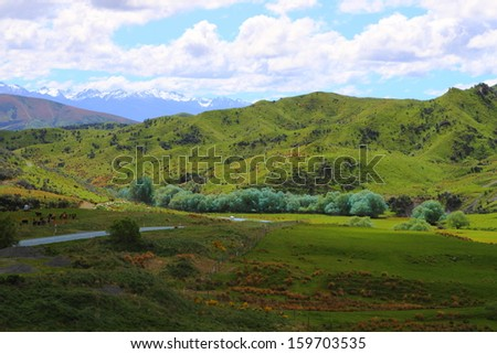 A road going through beautiful mountain vistas in  New Zealand - stock photo