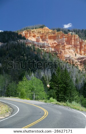 A road going through Yellowstone National Park - stock photo