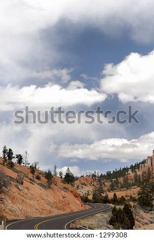 A road near Bryce Canyon USA winds through the warm desert. - stock photo