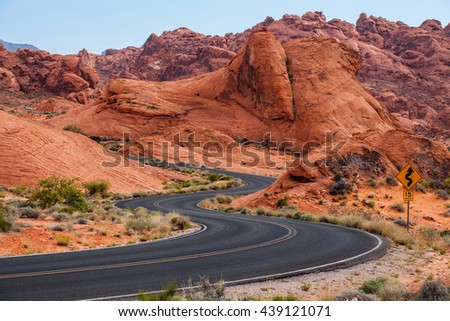 A road runs through it in the Valley of Fire State Park, Nevada, USA